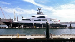 Luxury Private Yacht Docked In Sunny Harbor Stock Footage