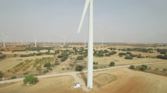 Sliding camera over wind turbine, aerial view Stock Footage