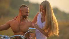 Man and woman on a motorcycle outdoors. Sport, recreation, nature. Stock Footage