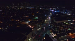 Beverly hills night drone fly over buildings cars lights Stock Footage