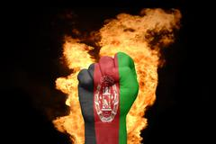 Fire fist with the national flag of afghanistan Kuvituskuvat
