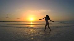 Asian Chinese girl in bikini on the ocean beach Stock Footage