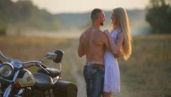 In love with a young beautiful couple on a motorcycle in the country. Stock Footage
