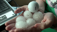Storm Chaser Holds Hail the Size of Golf Balls Stock Footage