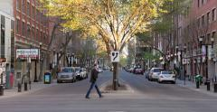 Hipster crosses street in historical neighborhood in Edmonton, Alberta - stock footage