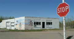 Abandoned gas station in rural town Stock Footage