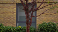 4K Exterior view, panning across windows of modern apartment block Stock Footage