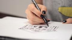 Young woman Drawing A Marker. black nail Polish Stock Footage