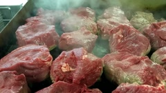 Frying a lot of filet mignon steaks, at a restaurant Stock Footage