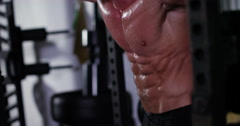 A muscular man drips sweat after a good workout. Shot on RED Epic. Stock Footage