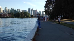 People jogging and riding bicycle in the Stanley park Stock Footage