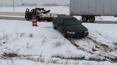 Strandard Car Being Towed out of Snowy Ditch Stock Footage