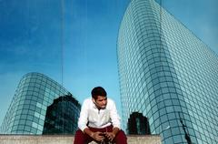 Young Indian business man talks on a smartphone - stock photo