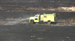 Fighting Grass Fire Stock Footage