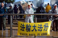 Chines people practicing Falun Dafa in Aotea Square in Auckland New Zealand - stock photo