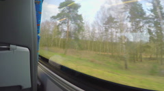 Point of view of passenger traveling by bus, looking outside through window - stock footage