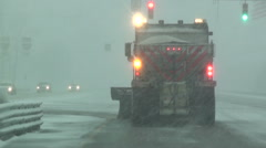 Snow Plow Getting to Roll in Colorado Snow Storm - stock footage