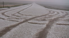 Tire Tracks in Hail Stock Footage