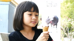 Asian kid licking ice cream. Stock Footage