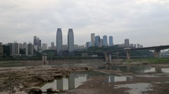 Changjiang river and shoreside skyscraper in Chongqing City of China Stock Footage