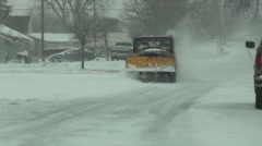 Snow Plow Driving up Street During Snowstorm Stock Footage