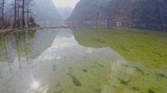 Clean bottom of lake with clear fresh water, mountain reflection, natural beauty - stock footage