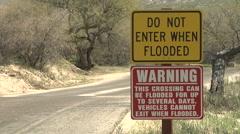 Flood Warning Sign by Arizona Highway Arroy Crossing near Tucson Stock Footage