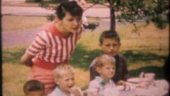 2505 - children enjoy backyard birthday party - vintage film home movie Stock Footage