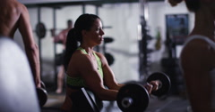 Female professional body builder lifting weights at the gym. Shot on RED Epic. Stock Footage