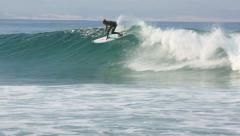 Australian professional surfer Ace Buchan riding a wave - stock footage