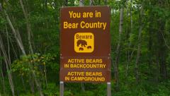 Beware of Bears sign in provincial park. Ontario, Canada. Handheld shot. Stock Footage