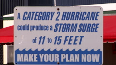 Zoom out from a Warning hurricane sign board.  Stock Footage