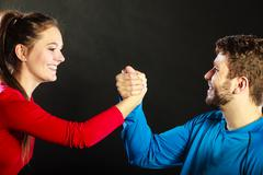 Friends man and woman clasping shaking hands. Stock Photos