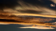 Mountain wave clouds glow in variety of Colorado sunset colors - stock footage