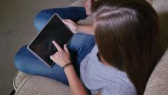 Teen Girl Watches Content on Tablet PC in Living Room - stock footage