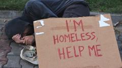 Homeless man sleeping 3 Stock Footage