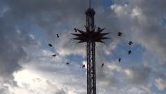 Fair Attraction Ride - Lifting and Flying - Chain Wheel Star Stock Footage