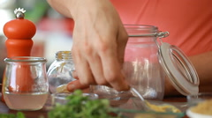 Cook's hands preparing vegetable salad - lemon juice Stock Footage