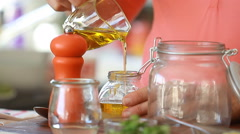 Cook's hands preparing vegetable salad - pouring olive oil Stock Footage