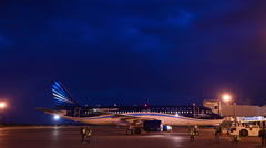 Photographers in the night at the plane spotting Stock Footage