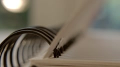 Artist Turning Pages in Sketchbook Portfolio - Close Up HD Stock Footage