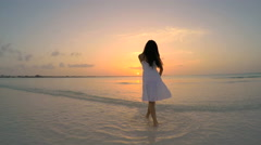 Asian Chinese girl in travel vacation resort barefoot Stock Footage
