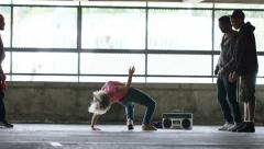 4K Flexible breakdancer shows her moves, shot on Red Epic Dragon - stock footage