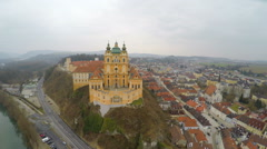 Aerial view of Melk Abbey in Austria, foggy spring day in old European city Stock Footage