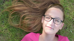 Happiness concept, teenage girl smiling, shoot from above - stock footage