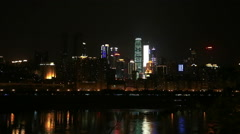Skyline of chongqing city beside changjiang river at night Stock Footage