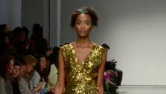 Attractive African American Model Walks with a Gold Dress Stock Footage