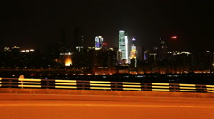 Traffic beside changjiang river and skyline of chongqing city at night Stock Footage