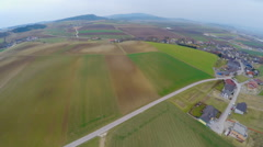 Flying over cultivated fields, green pastures, farmland. Agricultural industry Stock Footage