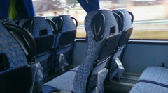 Empty seats inside a low-budget bus, traveling in economy class. Tourism Stock Footage